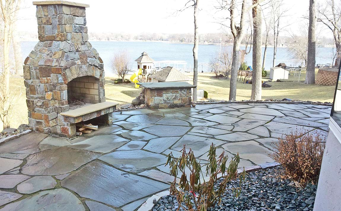 Natural Stone Patio with Wood Bruning Fireplace