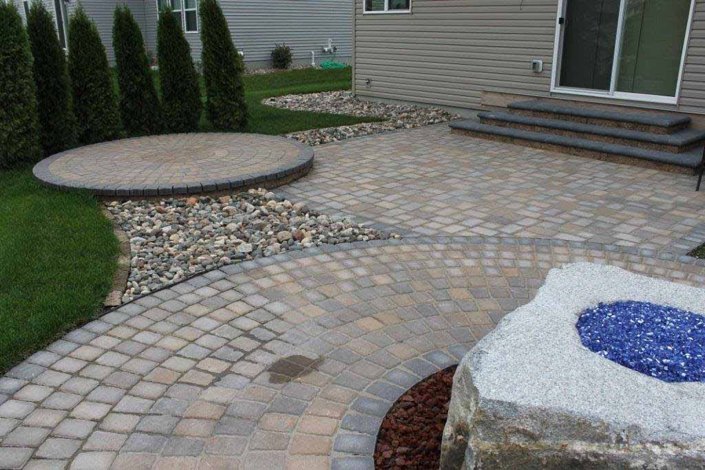 Backyard landscaping with pavers by Fredrickson Lawn and Landscape