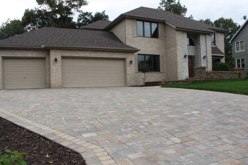 Custom paver driveway by Fredrickson Lawn and Landscape