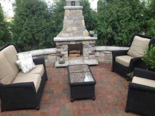 natural stone outdoor patio with fireplace by Fredrickson Lawn and Landscape